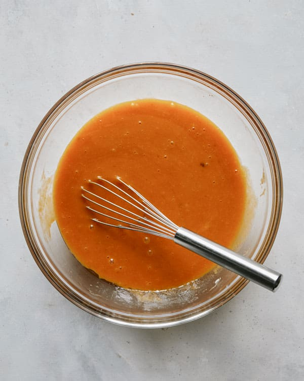 Wet ingredients whisked together to make pumpkin bars recipe.